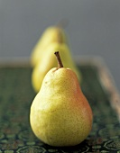 Trio of Yellow Pears on Green Asian Mat