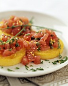 Tortini di polenta (Polenta rounds topped with tomatoes & capers)