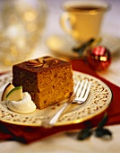 A Piece of Gingerbread Cake with Whipped Cream