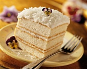 Slice of White Layer Cake with Coconut Frosting