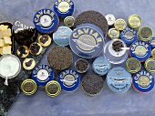 Lots of different kinds of caviare in tins