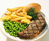 Grilled New York Strip Steak with French Fries and Peas