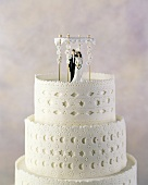 A Three Tiered Wedding Cake/ Chuppa with Bride and Groom