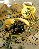 A Bowl of Olives with Bread and Olive Oil