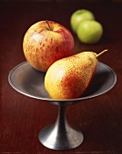 A Ripe Bartlett Pear and a Gala Apple in a Pewter Dish