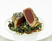 Tuna Steak with Sesame Crust on a Bed of Greens