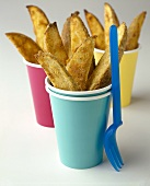 Potato Wedges in Paper Cups; Plastic Fork