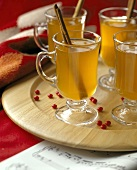 Hot Cider with Cinnamon Sticks in Glass Mugs