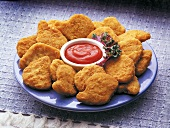 Chicken Nuggets on a Plate with Ketchup (not available for advertising use)