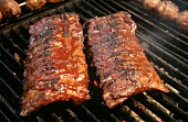 Two Racks of Baby Back Ribs on Grill