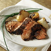 Strips of Flank Steak with Roasted Onions and Chives