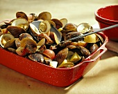 Steamed Clams with Kielbasa and Potatoes in Red Enamel Casserole