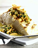 Barbecued fish fillet with almond salsa