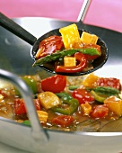 Sweet and sour vegetables, cooked in wok