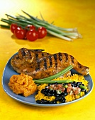 Half a barbecued chicken with beans and rice