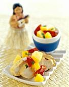 Sliced Chicken Breast with Mango Salsa; Hula Doll