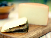 Wedges of Manchego Cheese on Wooden Board