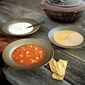 Three Assorted Soups in Bowls; Crackers