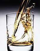 Pouring Whisky into Glass; Splash