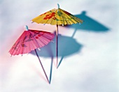Two cocktail umbrellas