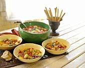 Vegetable soup with noodles; grissini