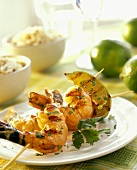 Barbecued shrimp kebab with wedges of lime