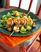 Caesar salad with grilled shrimp and scallop kebabs