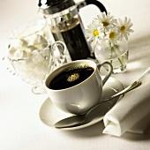 Black coffee in white cup; sugar lumps