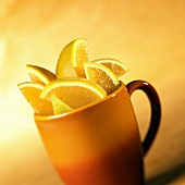 Orange wedges in large cup