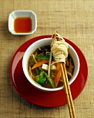 Asian vegetable soup with tofu and soba noodles