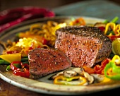 Beef steak with fresh pepper, vegetable accompaniments