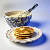 A Stack of Pancakes with Butter and Syrup; Batter