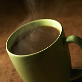 Steaming Black Coffee in a Green Mug