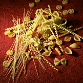 Assorted Dried Pasta on Red Background