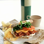 Ham, cheese and tomato sandwich; crisps