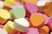 Colourful sugar hearts (filling the picture)
