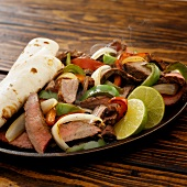 Traditional beef fajitas in frying pan