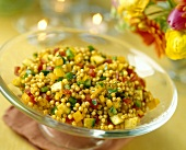 Spicy Couscous Salad with Bell Peppers in a Glass Pedestal Bowl