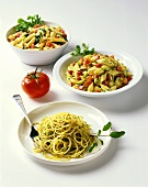 Three noodle dishes with vegetables