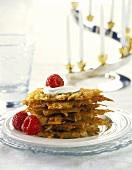 Latkas (potato pancakes) with sour cream and raspberries
