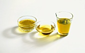 Olive Oil in a Glass and Two Small Bowls