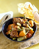 Lamb stew with okra pods and pumpkin