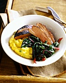 Barbecued duck breast with Swiss chard and polenta