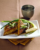 Fried tofu with sesame and spring onions