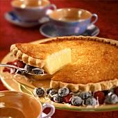 Vanilla cream and coconut pie, a slice cut