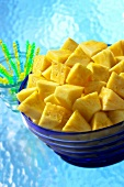 Pineapple pieces in a glass bowl