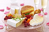 Platter of various soft cheeses and berries