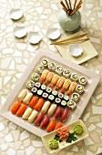 Sushi platter, bowl of wasabi and preserved ginger