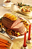 Festive roast ham, slices carved on serving plate