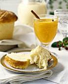 Brioche and glass of orange juice